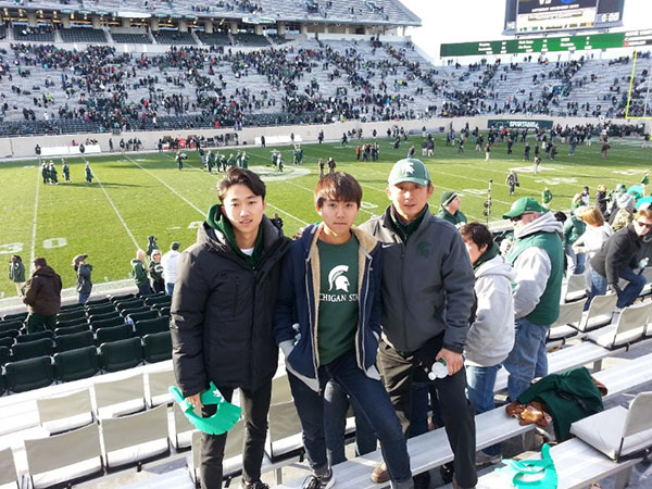 Changwon Lee with his two sons after the MSU vs. Maryland football game.